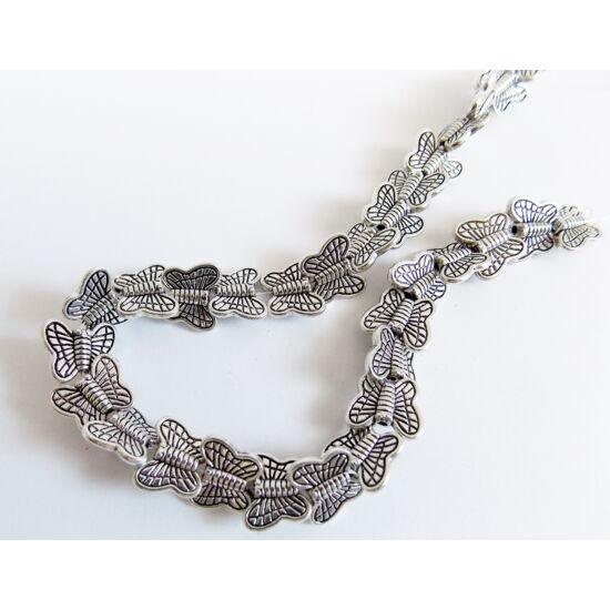 Tibeti Pillangó formájú, lapos köztes gyöngy, antik ezüst színben