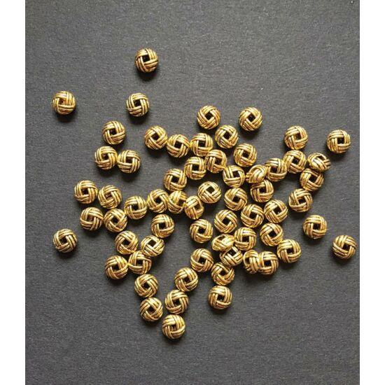 Tibeti geometrikus mintájú, lapos kerek köztes gyöngy, antik arany színben