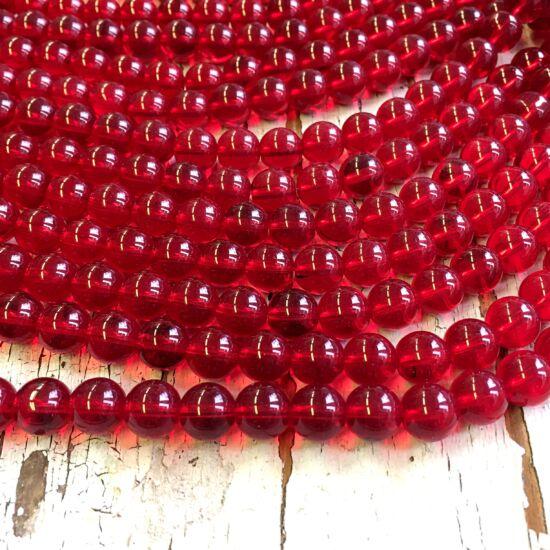 Üveggyöngy - áttetsző -  piros - csiszolt - gömb