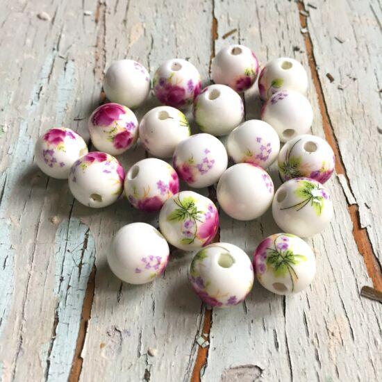 12mm Porcelán gyöngy, fehér alapon fuchia virág díszítéssel
