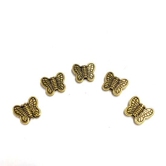 Köztes gyöngy - pillangó - antik arany színben