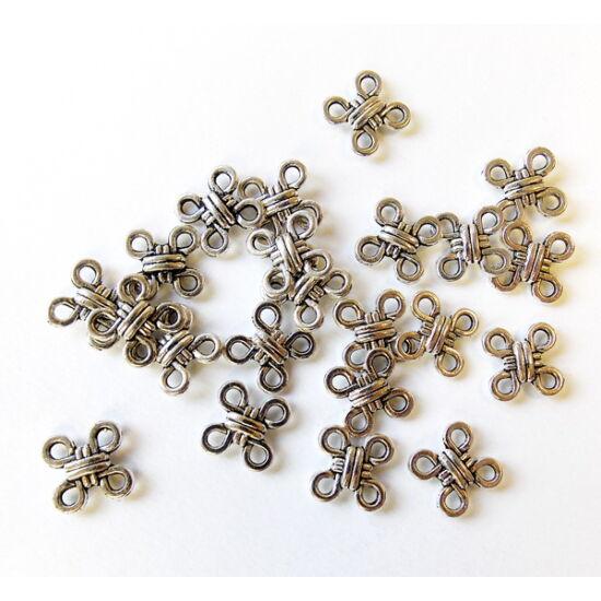 Antik ezüst színű, végtelenség csomó alakú, fém köztes