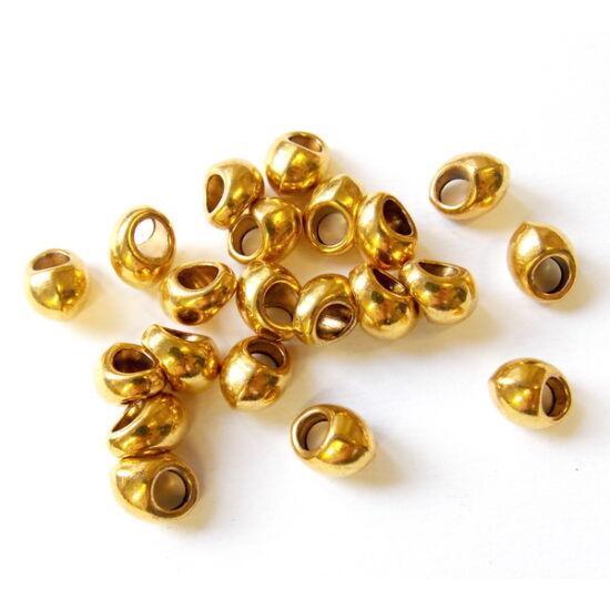 Arany színű, csepp alakú köztes gyöngy